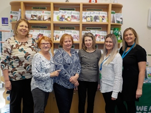 From left to right: Sandra Buckley, Jean Hand, Val Welden, Rita Gunshon (all volunteers), Sarah Plant (Macmillan Information & Support Assistant) and Charlotte Brosnan (Macmillan Information & Support Service Manager).